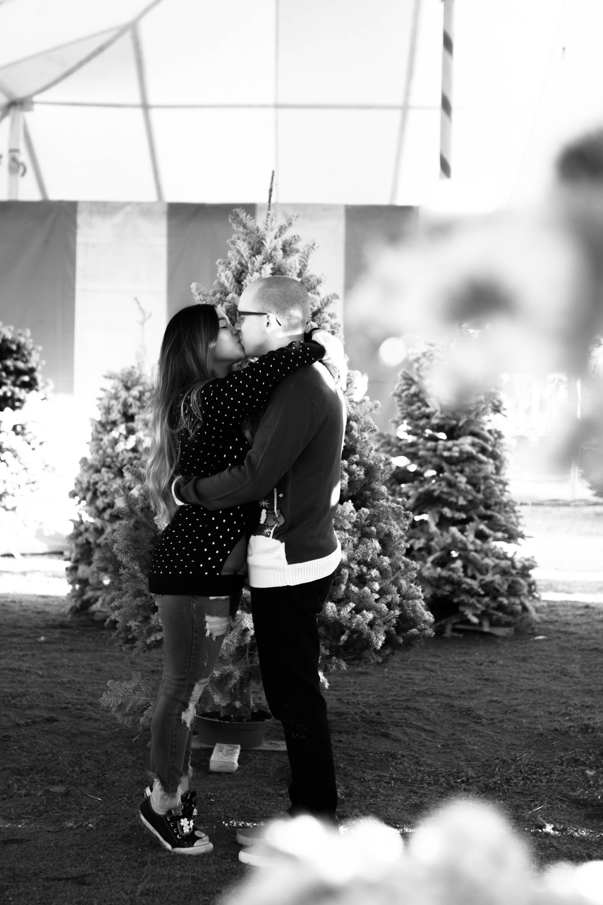 Christmas Couple Kissing Mistletoe