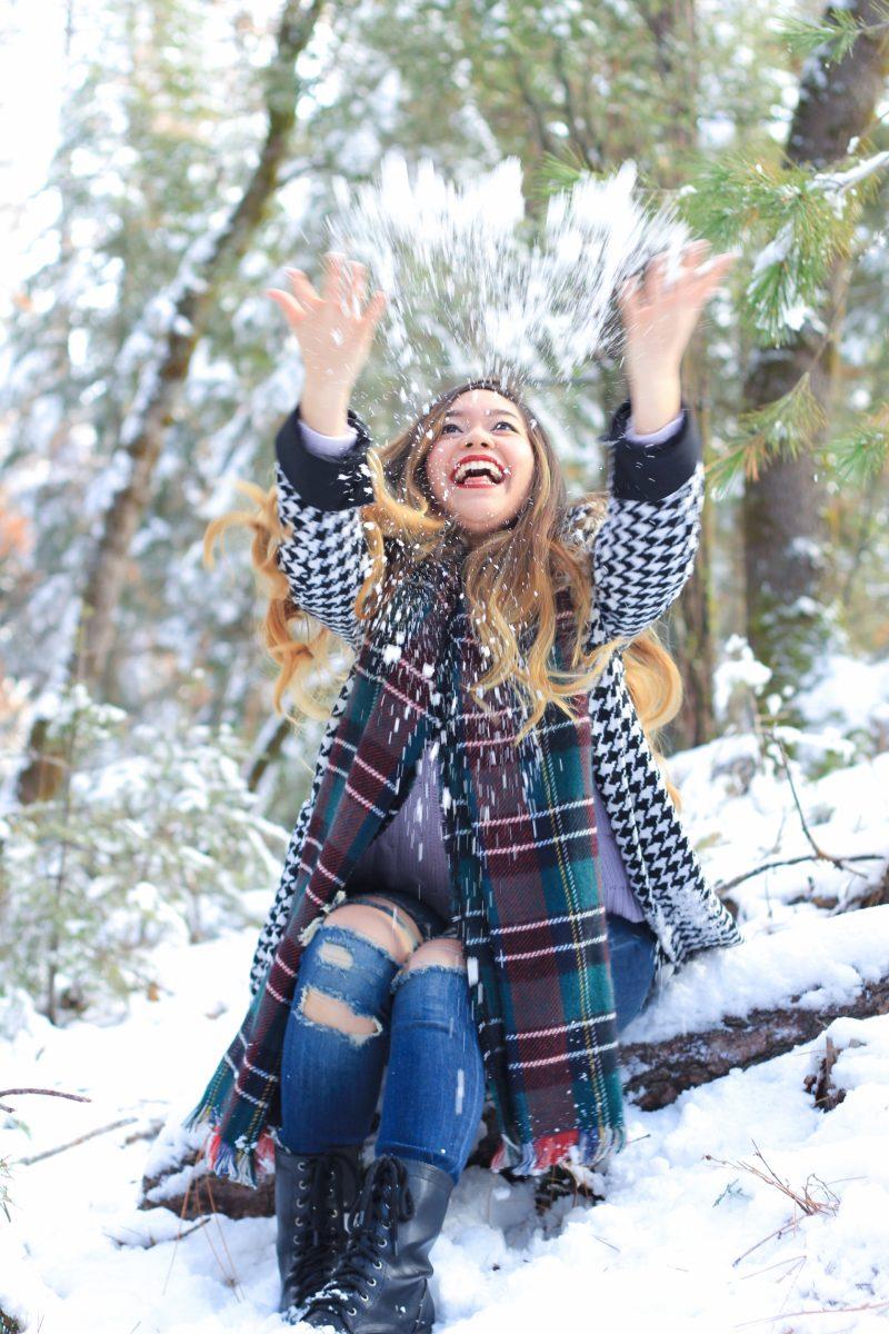Girl Throwing Snow