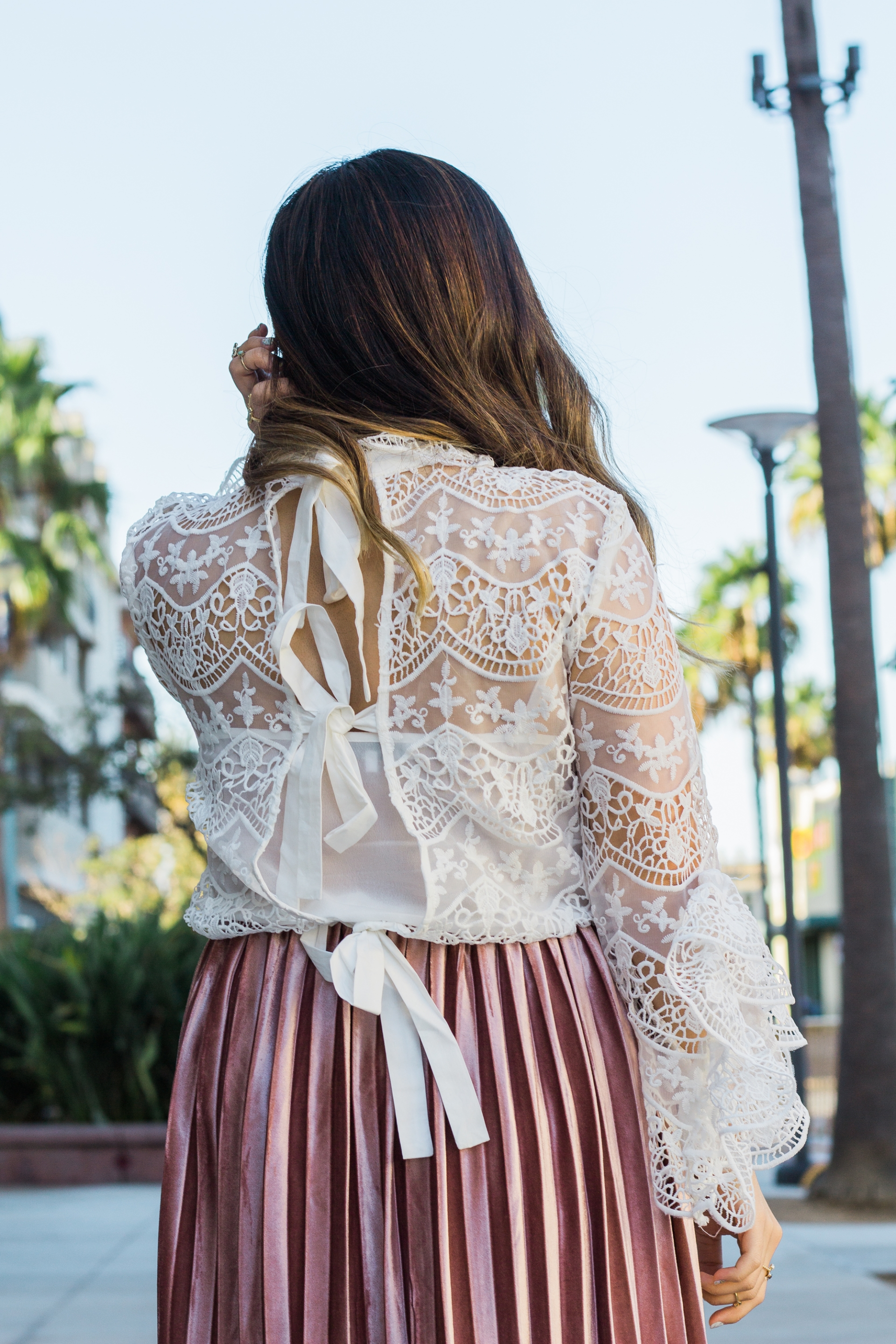 Revolve Endless Love Ribbon Ties Crochet Lace Top Embroidered Crochet Lace Overlay Top with Back Tie Closures Ruffle Collar Trim And Extravagant Bell Sleeves Baby Pink Velvet Pleated Midi Skirt