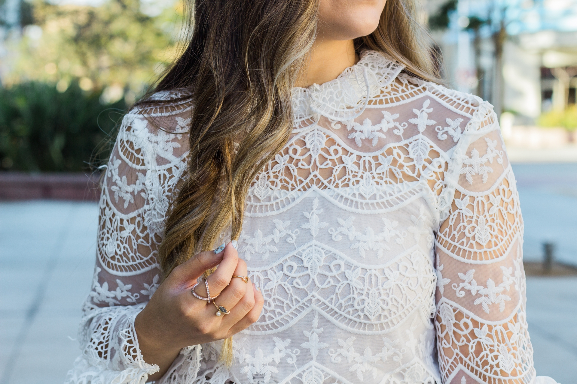Revolve Endless Love Ribbon Ties Crochet Lace Top Embroidered Crochet Lace Overlay Top with Back Tie Closures Ruffle Collar Trim And Extravagant Bell Sleeves